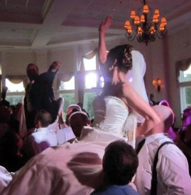 Raising the Bride and Groom at a Jewish Wedding Celebration