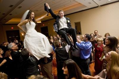 Raising the Bride and Groom with Over Flowing of Joy!
